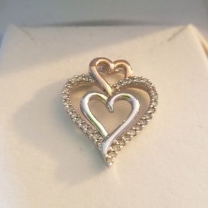 Stearling pendant with real diamonds. Never worn.